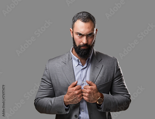 Fotografie, Obraz Serious, bearded male dressed in a grey suit.