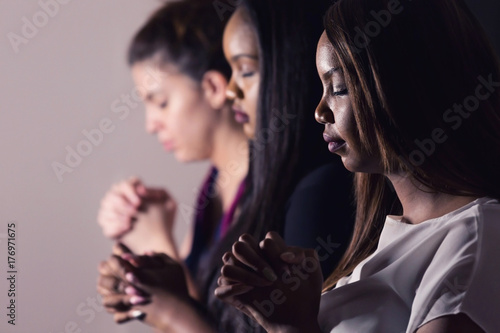 Fototapeta Young Devoted Women Praying Together