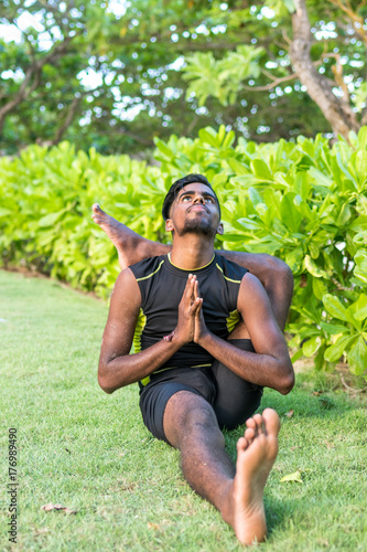Young Yoga Man Practitioners Doing Yoga On Nature Asian Indian Yogis Man On The Grass In The Park Bali Island Buy This Stock Photo And Explore Similar Images At Adobe Stock