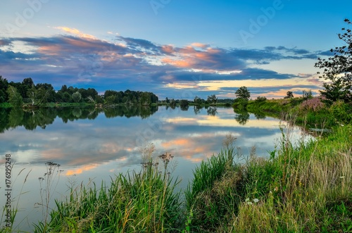 Tuinposter Blauwe jeans Beautiful summer landscape. Pond in the countryside in fabulous evening colors.