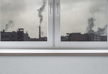 Air Pollution Over The City And Clean White Window Frame With Sill