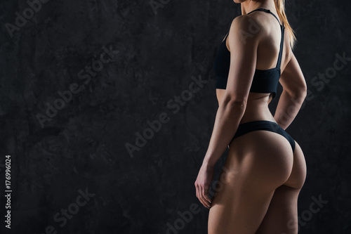 Deurstickers Ezel Healthy lifestyle diet and fitness. Beautiful slim woman's body. Perfect slim toned young body of the girl. Fitness or plastic surgery and aesthetic cosmetology. Taut elastic ass. Firm buttocks