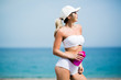 Gorgeous fit young woman with water bottle on the beach