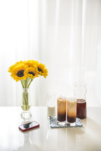 Delicious Milk Tea And Beautiful Sunflower On Table.