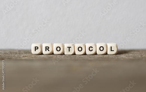 Fotografía  Word PROTOCOL made with wood building blocks