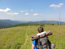 Man Hiking In Mountains With B...