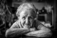 Black-and-white Closeup Portrait Of An Elderly Woman.