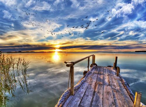 Plakat zachód słońca w lagunie Walencji
