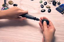 Jeweler Working With Dremel