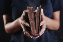 Hands Of A Woman Opened A Dusty Old Book.
