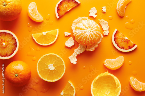 Citrus fruits on orange background
