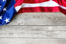 American Flag Over Wooden Background