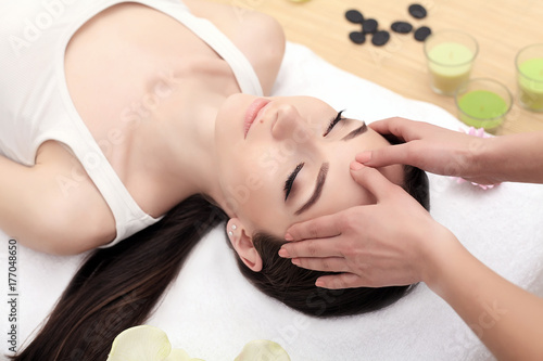 Face Massage. Close-up of a Young Woman Getting Spa Treatment. Wallpaper Mural