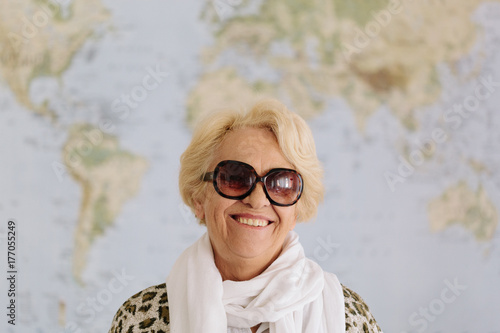 Senior Woman portrait in front of a world map