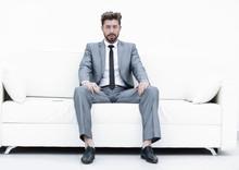 Successful Businessman Sitting...