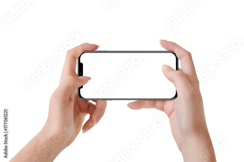 Fotografía  Female hands holding modern black phone in horizontal position, isolated on whit