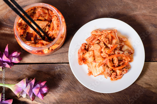 Korean food, kimchi cabbage on white dish and a jar with chopsticks for eating,top view of food
