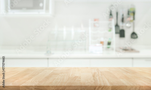 Wood table top on blur kitchen room background Wallpaper Mural