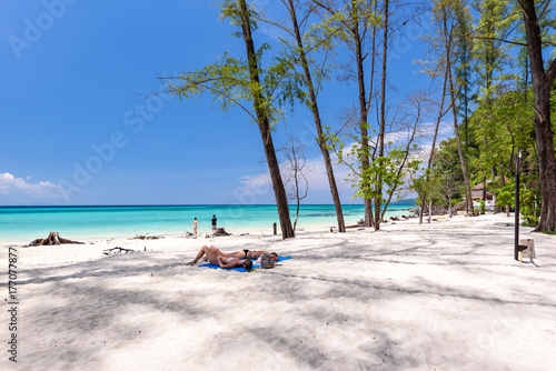 Ladies lie on the sand at beautiful beach of bamboo island near Phi Phi islands Wallpaper Mural