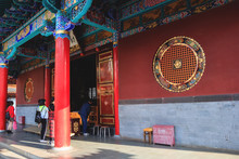 Buddhist Temple In China With People Paying Their Respects
