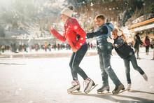 Happy Family Outdoor Ice Skati...