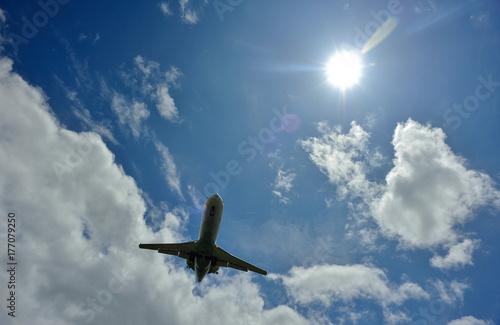 Plakat Słońce i samolot.