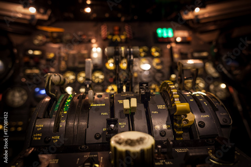 Control levers in airplane cockpit closeup with selective focus. Canvas Print