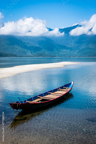 The Boat on the side of the lake in Vietnam Poster