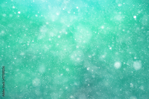 Fotografiet  Snowfall texture of snowflakes on blurred background