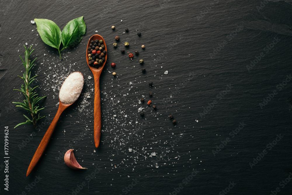 Fototapety, obrazy: Sea salt and mixed peppercorn on dark black slate board. Top view. Copy space.
