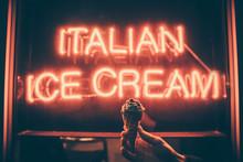 Board Sign Saying Italian Ice Cream With Hand Holding Ice Cream Cone