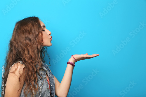 Fotografie, Obraz  Portrait of young woman on blue background