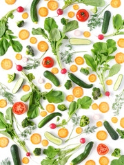 FototapetaFresh vegetables and greens on a white background. Pattern of vegetables. Radish, carrots, tomatoes, cucumbers, dill isolated on white background. Vegetable background wallpaper.Top view, flat lay.