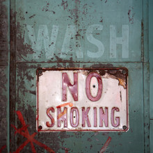 A Worn And Rusty No Smoking Sign