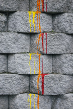 Red, Orange And Yellow Paint Dripping Down Brick Wall