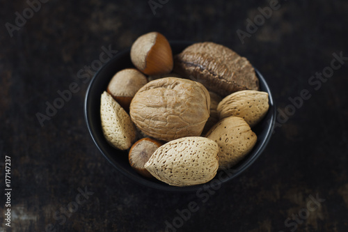 Bowl of whole mixed nuts in the shell