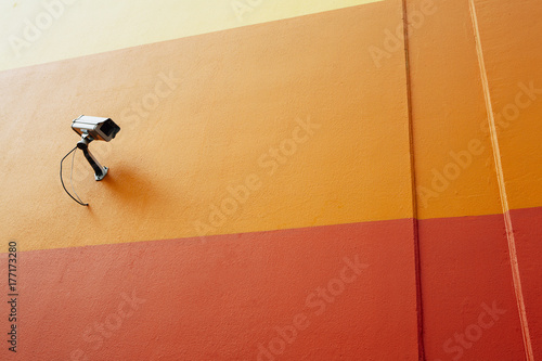 Surveillance camera on colorful building wall