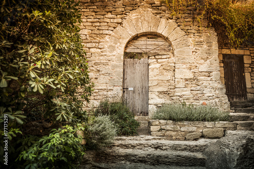 Archway (gate) And Historic Stone Wall In The Garden Nook