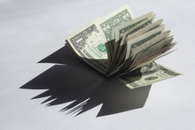 US Dollar Bills On A White Bac...