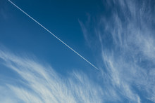 Airplane Contrail Across Sky