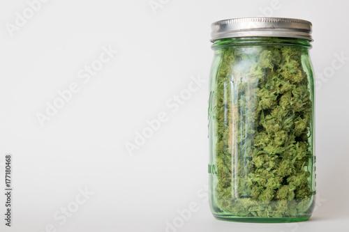 Fényképezés  Jar of medical marijuana; off center