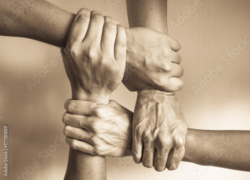 Cuadros en Lienzo Stack of hands showing unity and teamwork