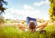 Chilling out in nature. Young girl lying on the grass on a beautiful sunny day.