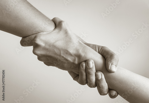 Fotografia Two hands helping another. People helping each other.