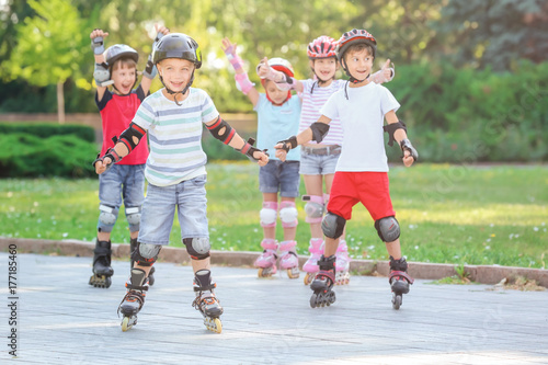 Active children rollerskating in park