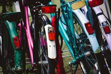 Colorful Commuter Bikes In A Bike Rack.
