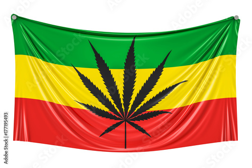 Fototapeta  Rasta Flag, Cannabis leaf on Rastafarian flag hanging on the wall, 3D rendering