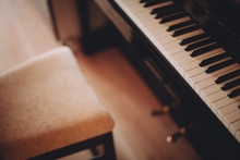 Grand Piano And A Chair