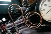 Copper Pipe And Pressure Gauge On An Old Steam Engine