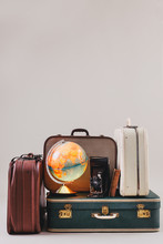 Vintage Suitcases With A Globe...